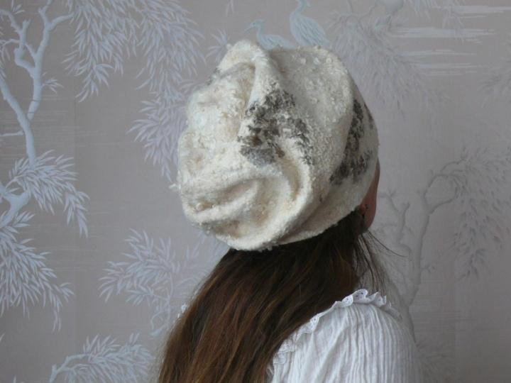 Moteriška kepurė.