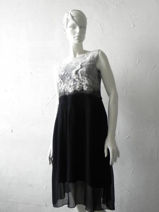 Elegantiska velta suknele.