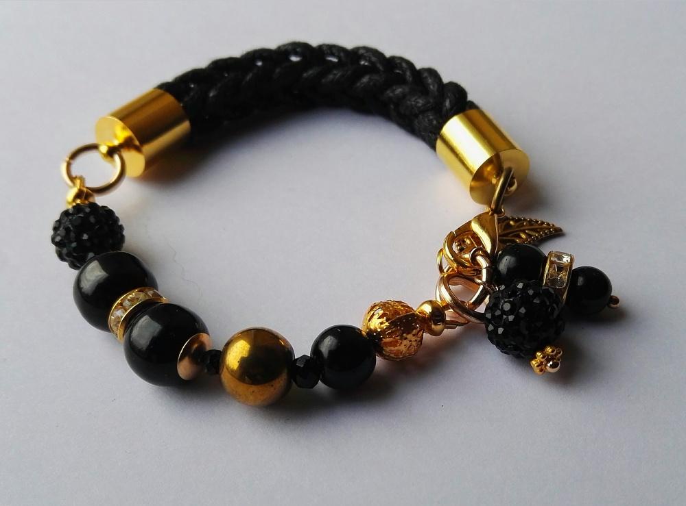 Apyrankė auksinės ir juodos spalvos