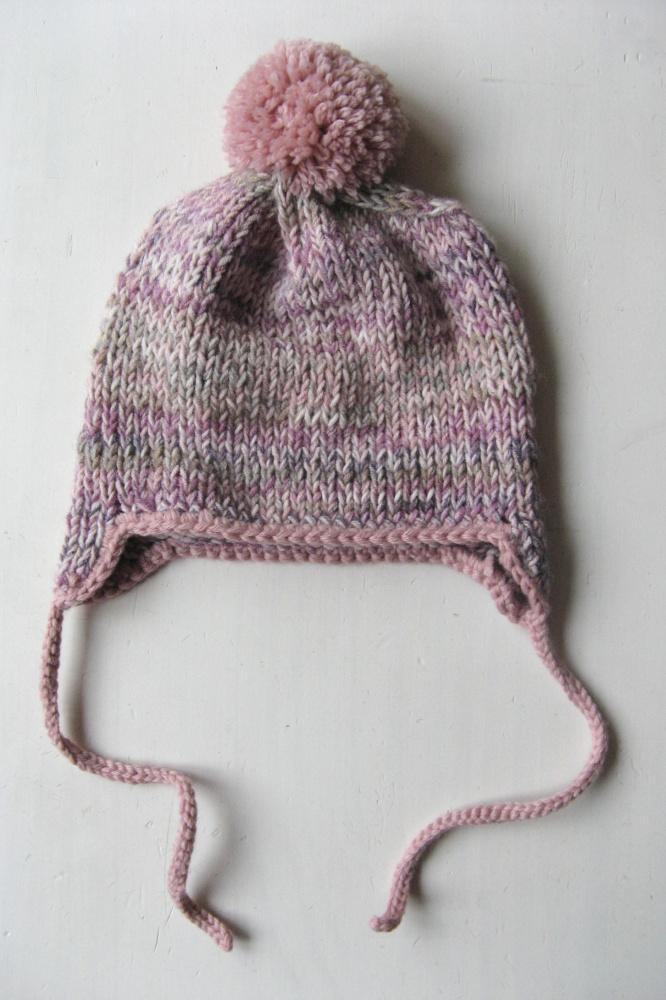 švelniai alyvinė žieminė kepuraitė