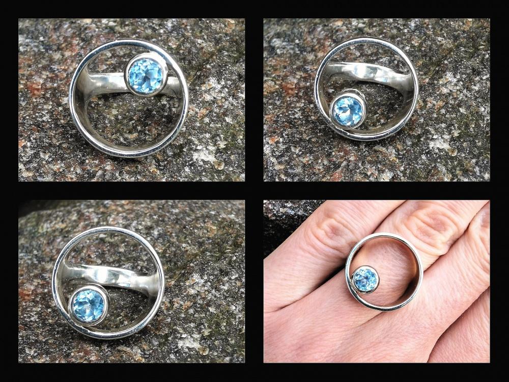 Žiedas kiauras su topazu žydru.